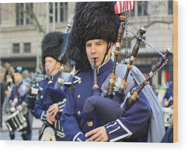 Bag Piper Wood Print featuring the photograph A Bagpiper Marching In The 2009 New York St. Patrick Day Parade by James Connor