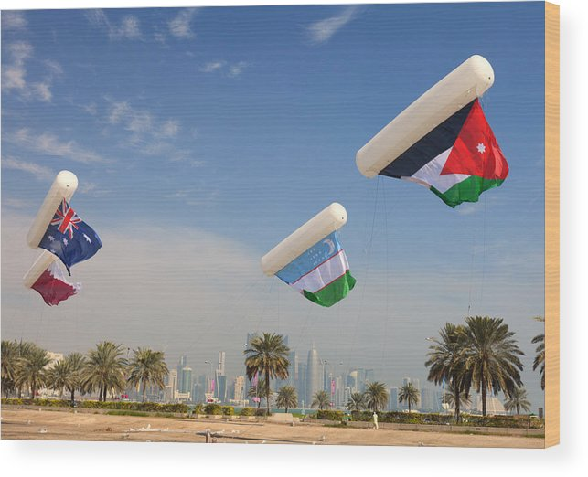 Doha Wood Print featuring the photograph Flags Over Doha by Paul Cowan