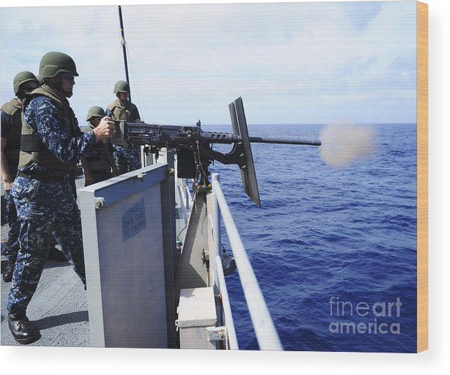 Military Wood Print featuring the photograph Master-at-arms Fires A .50-caliber by Stocktrek Images
