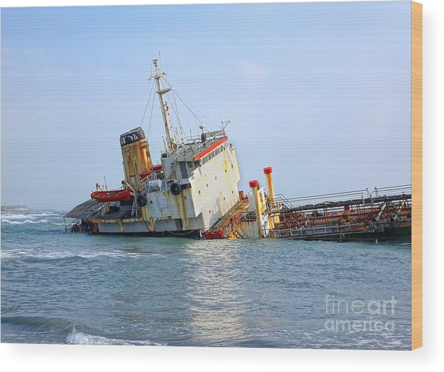 Shipwreck Wood Print featuring the photograph Shipwrecked Diesel Tanker by Yali Shi