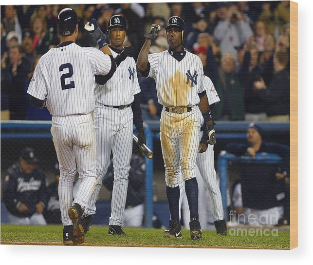 Alfonso Soriano Wood Print featuring the photograph Alfonso Soriano, Derek Jeter, And Bernie Williams by Al Bello