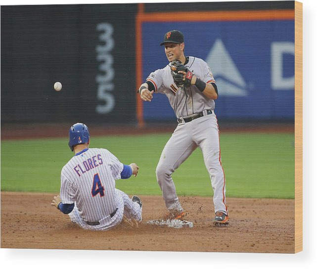 Double Play Wood Print featuring the photograph Joe Panik And Wilmer Flores by Al Bello