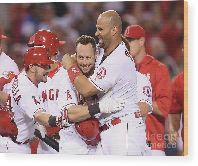 Ninth Inning Wood Print featuring the photograph Johnny Giavotella, Albert Pujols, And Daniel Nava by Stephen Dunn