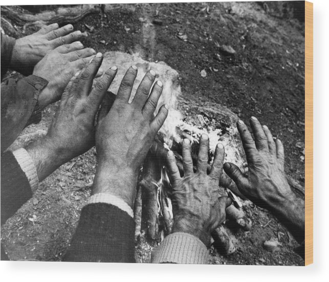 Concept Wood Print featuring the photograph Workers' Hands By The Fire by Emanuel Tanjala