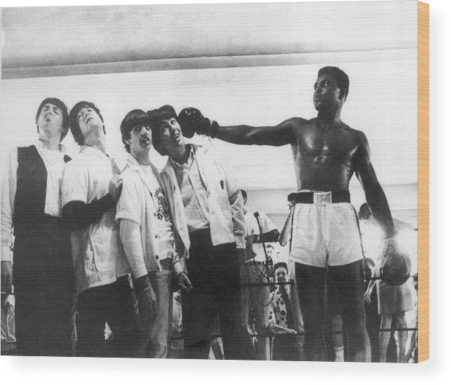Sports Training Wood Print featuring the photograph The Beatles And Muhammad Ali In 1964 by Keystone-france