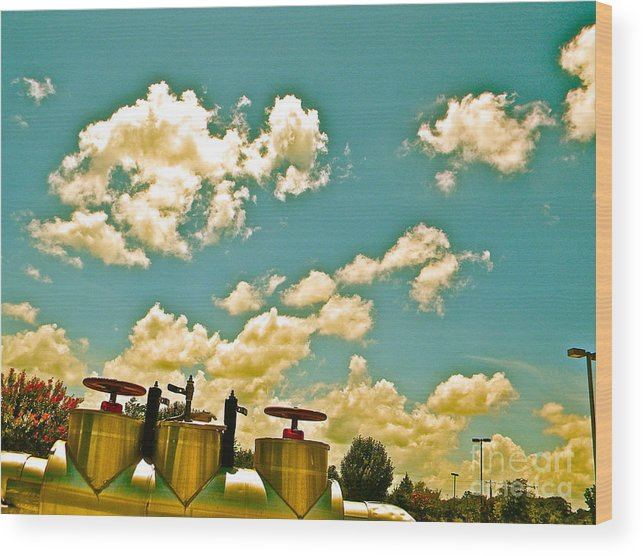 Clouds Wood Print featuring the photograph Clouds Over Oil Field Equipent by Chuck Taylor