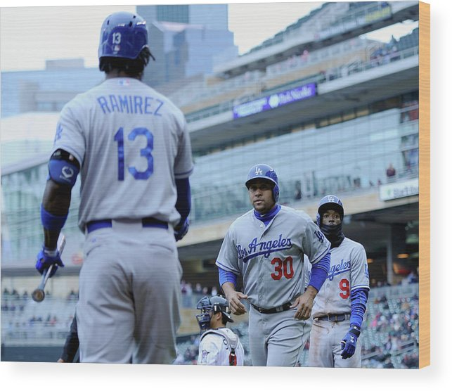 Second Inning Wood Print featuring the photograph Dee Gordon, Hanley Ramirez, And Miguel Olivo by Hannah Foslien