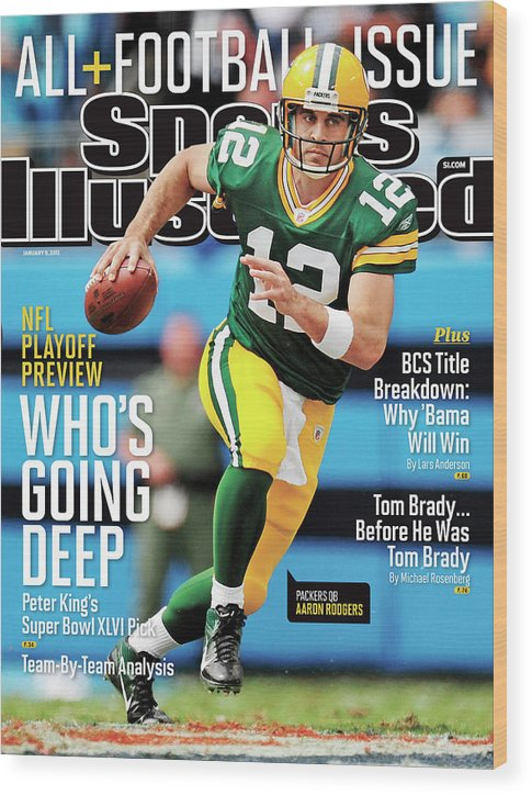 Magazine Cover Wood Print featuring the photograph Whos Going Deep 2012 Nfl Playoff Preview Issue Sports Illustrated Cover by Sports Illustrated