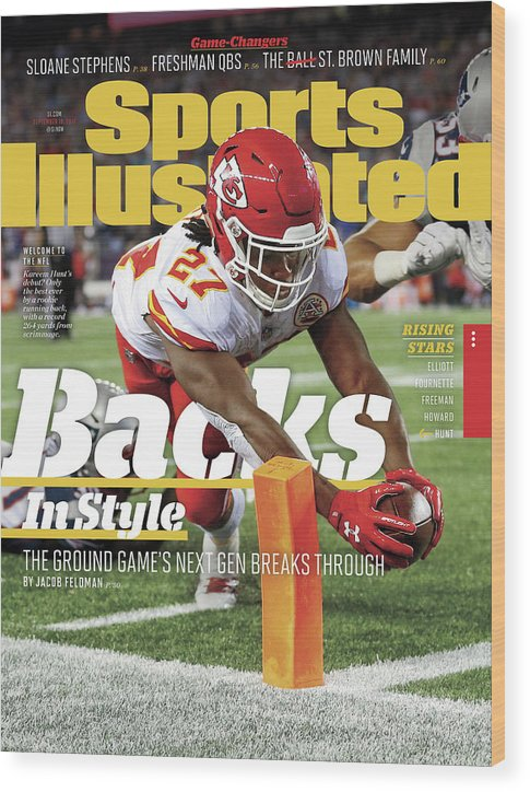 Magazine Cover Wood Print featuring the photograph Backs In Style The Ground Games Next Gen Breaks Through Sports Illustrated Cover by Sports Illustrated