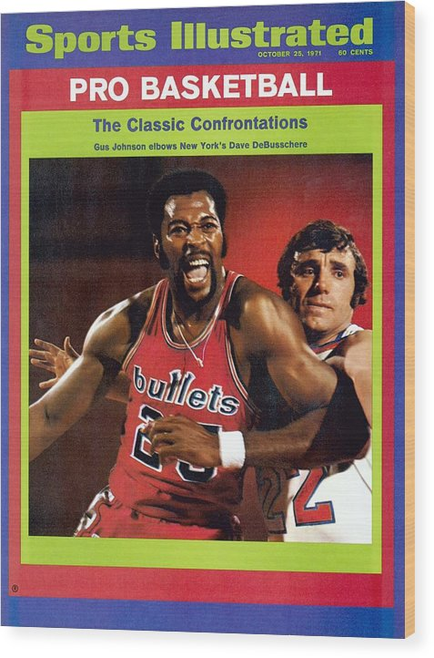 Magazine Cover Wood Print featuring the photograph Baltimore Bullets Gus Johnson And New York Knicks Dave Sports Illustrated Cover by Sports Illustrated