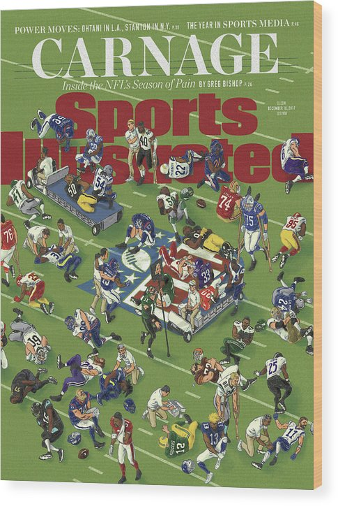 Magazine Cover Wood Print featuring the photograph Carnage Inside The Nfls Season Of Pain Sports Illustrated Cover by Sports Illustrated