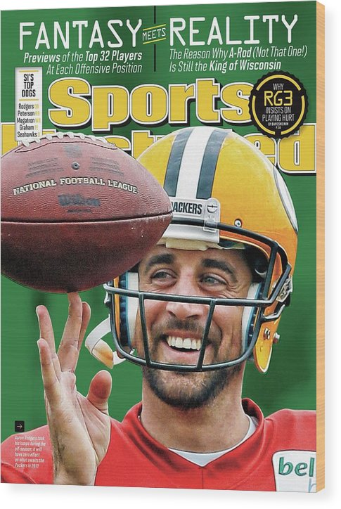Green Bay Wood Print featuring the photograph Fantasy Meets Reality 2013 Nfl Fantasy Football Issue Sports Illustrated Cover by Sports Illustrated