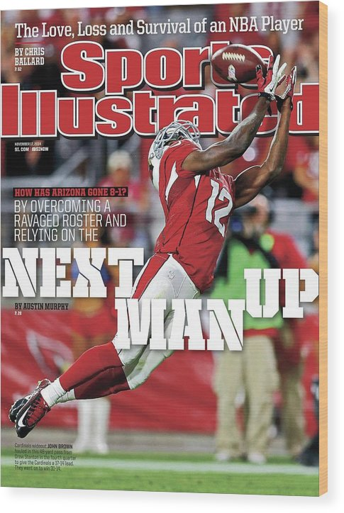 Magazine Cover Wood Print featuring the photograph How Has Arizona Gone 8-1 By Overcoming A Ravaged Roster And Sports Illustrated Cover by Sports Illustrated