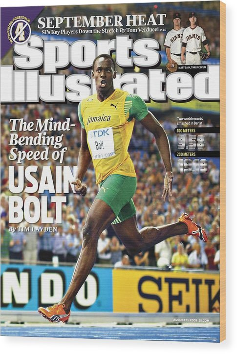 Magazine Cover Wood Print featuring the photograph Jamaica Usain Bolt, 2009 Iaaf World Championships In Sports Illustrated Cover by Sports Illustrated