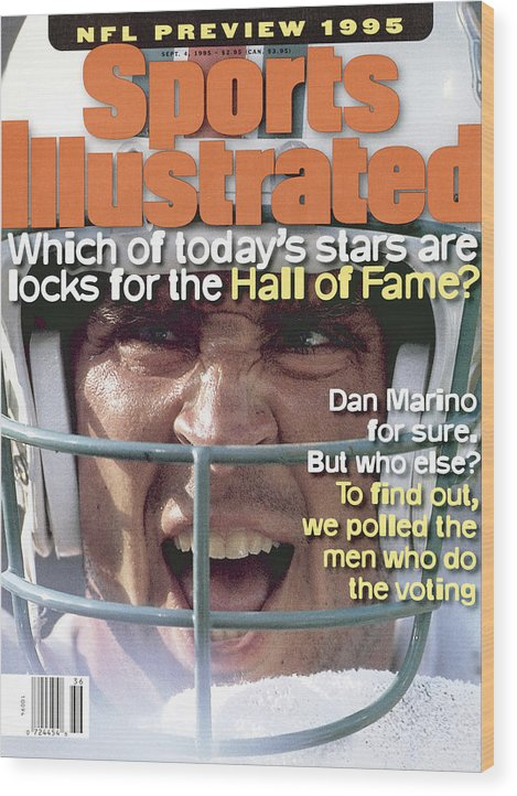 Magazine Cover Wood Print featuring the photograph Miami Dolphins Qb Dan Marino, 1995 Nfl Football Preview Sports Illustrated Cover by Sports Illustrated