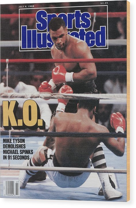 Magazine Cover Wood Print featuring the photograph Mike Tyson, 1988 Wbcwbaibf Heavyweight Title Sports Illustrated Cover by Sports Illustrated