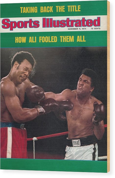 Magazine Cover Wood Print featuring the photograph Muhammad Ali, 1974 Wbawbc Heavyweight Title Sports Illustrated Cover by Sports Illustrated