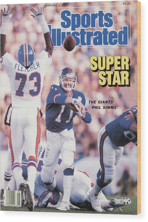 Magazine Cover Wood Print featuring the photograph New York Giants Qb Phil Simms, Super Bowl Xxi Sports Illustrated Cover by Sports Illustrated