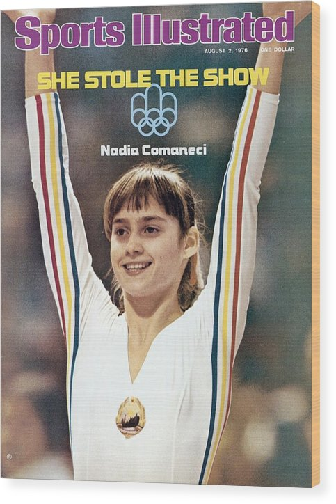 Magazine Cover Wood Print featuring the photograph Romania Nadia Comaneci, 1976 Summer Olympics Sports Illustrated Cover by Sports Illustrated