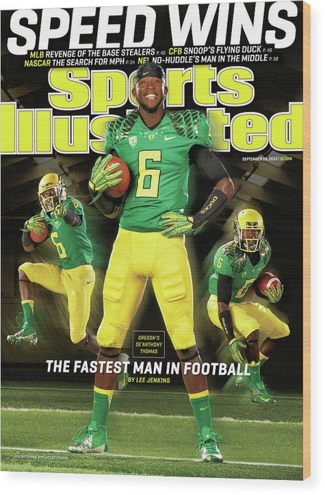 Magazine Cover Wood Print featuring the photograph Speed Wins Oregons Deanthony Thomas, The Fastest Man In Sports Illustrated Cover by Sports Illustrated