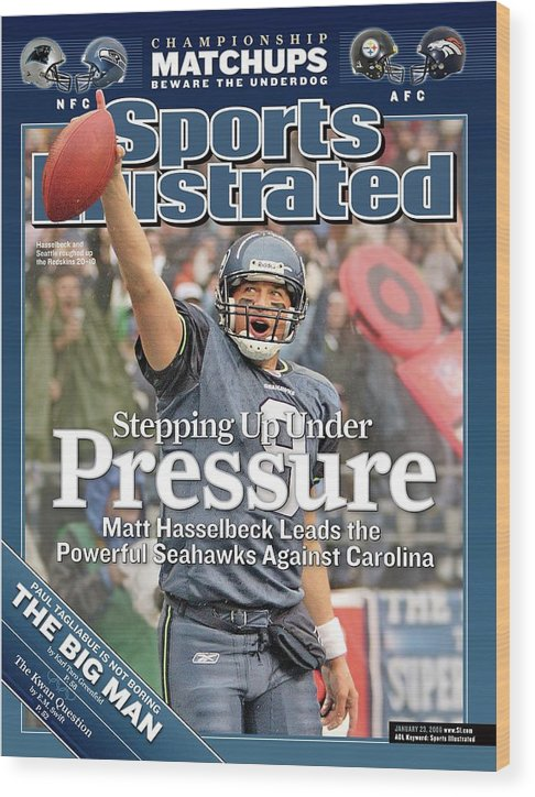 Magazine Cover Wood Print featuring the photograph Stepping Up Under Pressure Matt Hasselbeck Leads The Sports Illustrated Cover by Sports Illustrated