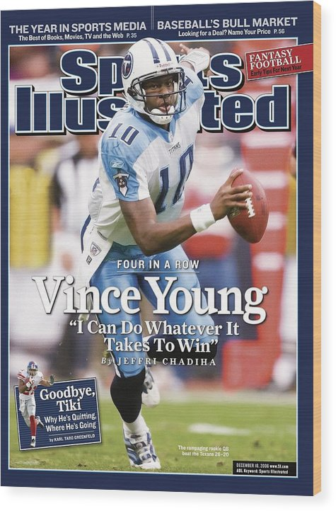 Magazine Cover Wood Print featuring the photograph Tennessee Titans Qb Vince Young... Sports Illustrated Cover by Sports Illustrated