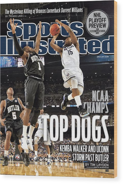 Kemba Walker Wood Print featuring the photograph University Of Connecticut Vs Butler University, 2011 Ncaa Sports Illustrated Cover by Sports Illustrated