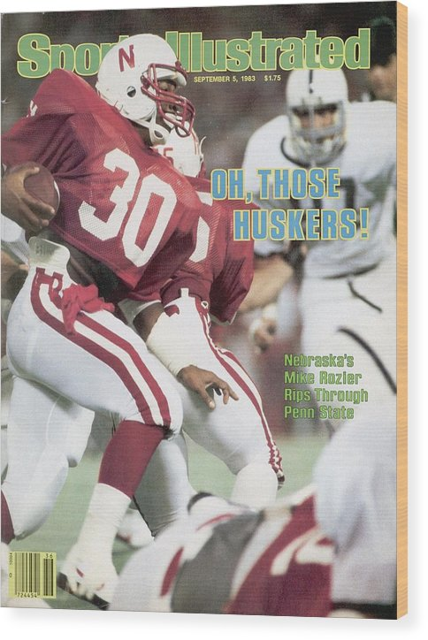 1980-1989 Wood Print featuring the photograph University Of Nebraska Mike Rozier, 1983 Kickoff Classic Sports Illustrated Cover by Sports Illustrated