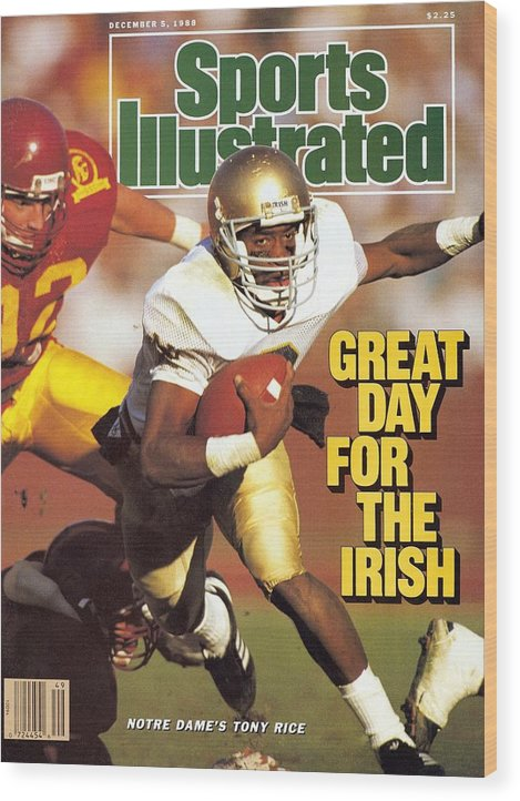 1980-1989 Wood Print featuring the photograph University Of Notre Dame Qb Tony Rice Sports Illustrated Cover by Sports Illustrated
