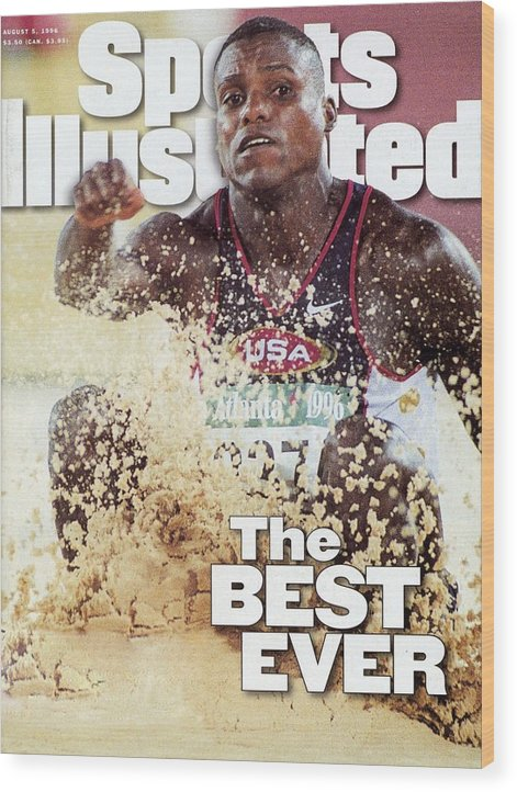 The Olympic Games Wood Print featuring the photograph Usa Carl Lewis, 1996 Summer Olympics Sports Illustrated Cover by Sports Illustrated