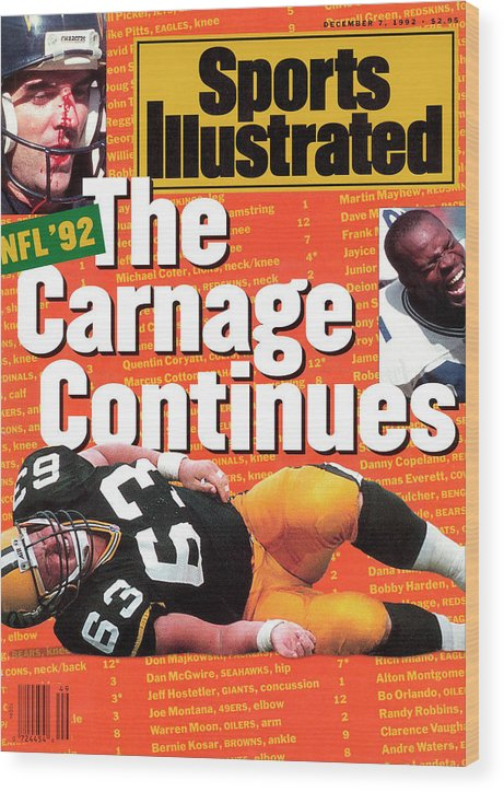 Magazine Cover Wood Print featuring the photograph Nfl Football The Carnage Continues Sports Illustrated Cover by Sports Illustrated