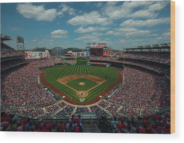 Motion Wood Print featuring the photograph Atlanta Braves V. Washington Nationals by Rob Tringali