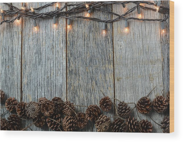 Christmas Lights And Pinecones On Rustic Wood Background Wood Print By Brandon Bourdages This dark brown wood texture has a natural look and a great. christmas lights and pinecones on rustic wood background wood print