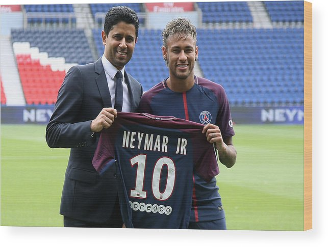 Following Wood Print featuring the photograph Neymar Signs For PSG by Jean Catuffe
