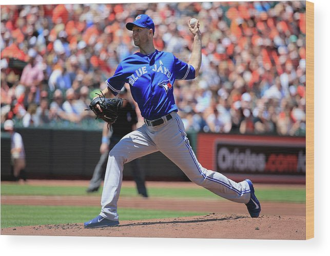 American League Baseball Wood Print featuring the photograph Toronto Blue Jays V Baltimore Orioles by Rob Carr