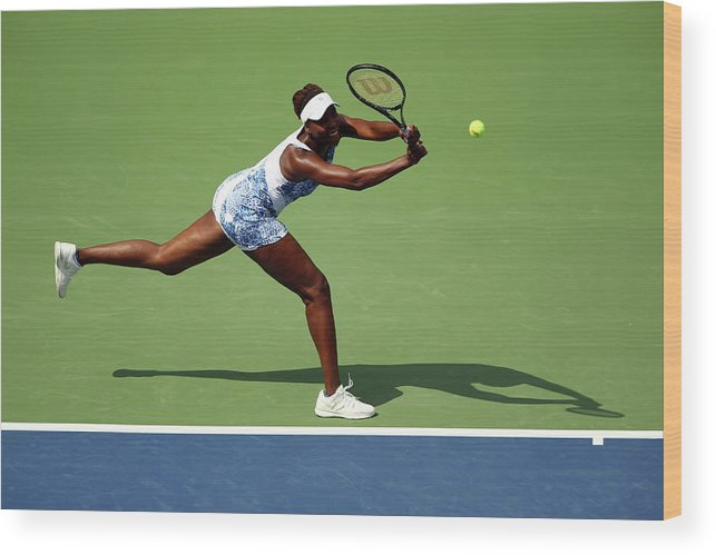 Monica Puig Wood Print featuring the photograph 2015 U.s. Open - Day 1 by Clive Brunskill