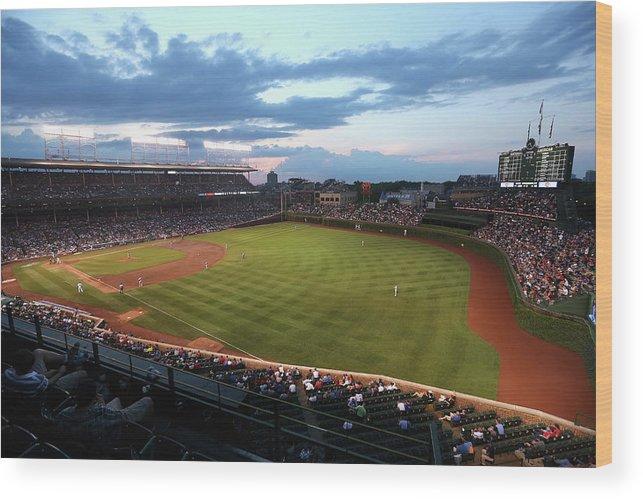 National League Baseball Wood Print featuring the photograph Cincinnati Reds V Chicago Cubs by Jonathan Daniel