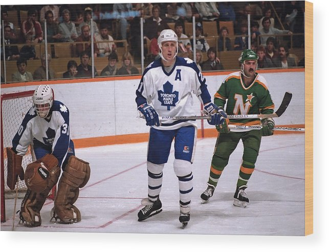 1980-1989 Wood Print featuring the photograph Minnesota North Stars v Toronto Maple Leafs by Graig Abel