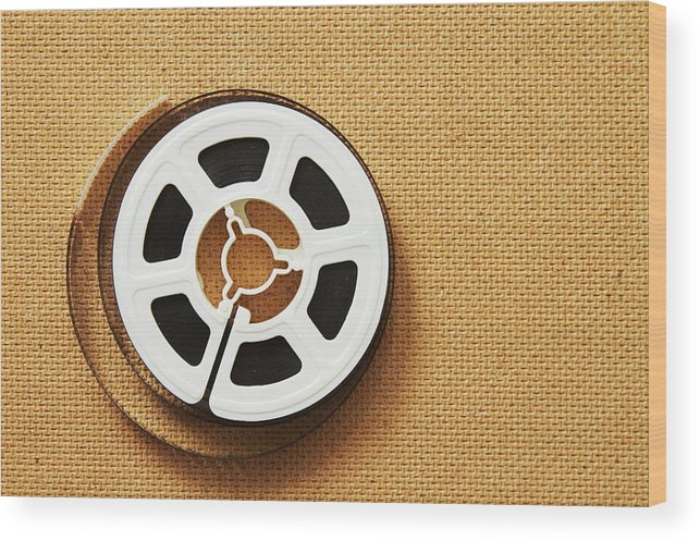 The Media Wood Print featuring the photograph A Reel, Or Spool, Of 8mm Movie Film by Jon Schulte