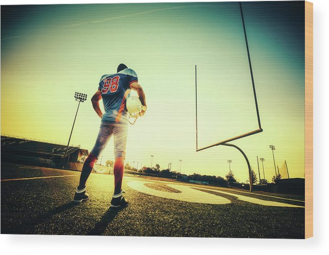 Headwear Wood Print featuring the photograph American Football Player by Ferrantraite