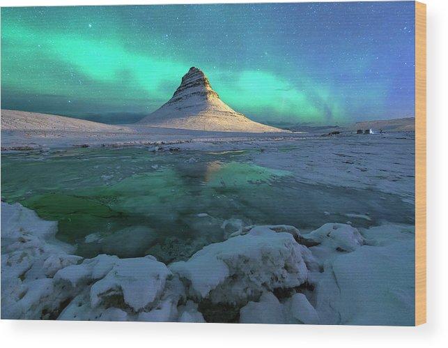 Tranquility Wood Print featuring the photograph Aurora Over Kirkjufell Mountain Iceland by Ratnakorn Piyasirisorost