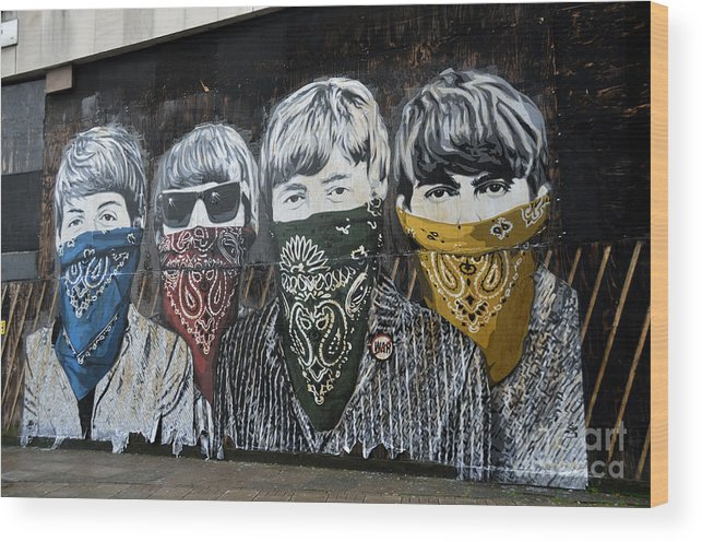 Banksy Wood Print featuring the photograph The Beatles wearing face masks street mural by RicardMN Photography