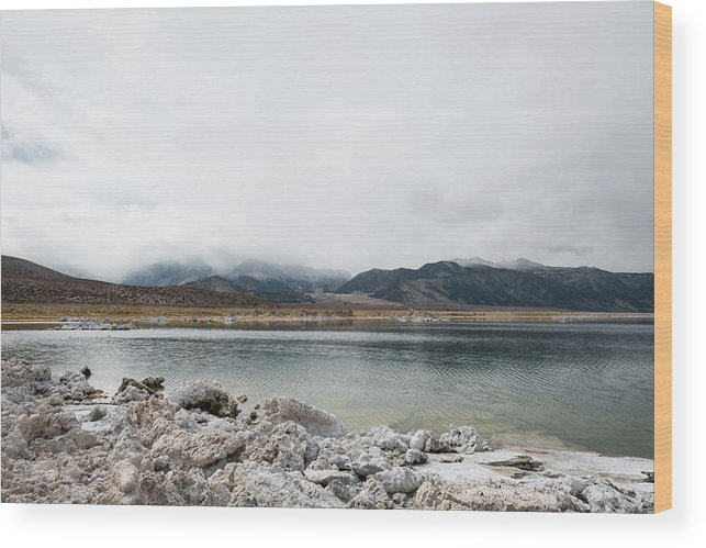 Tranquility Wood Print featuring the photograph Calm Lake Against Mountain Range by Christian Soldatke / EyeEm