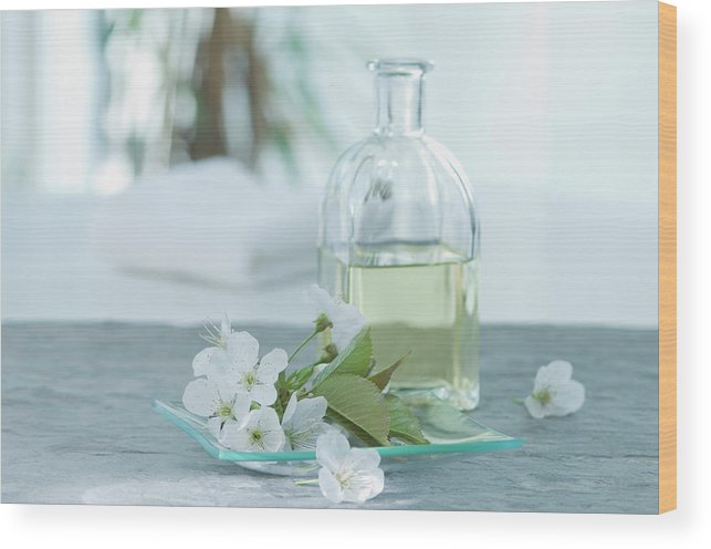 Spa Wood Print featuring the photograph Cherry Blossom With Aroma Oil, Close Up by Westend61
