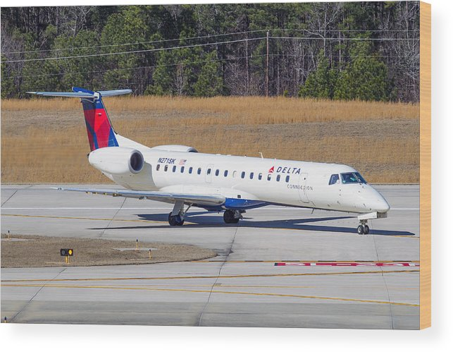 Wood Print featuring the photograph Delta Airlines ERJ-145LR by Richard Jack-James