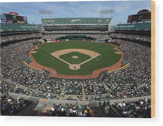 American League Baseball Wood Print featuring the photograph Detroit Tigers Vs. Oakland Athletics by Brad Mangin