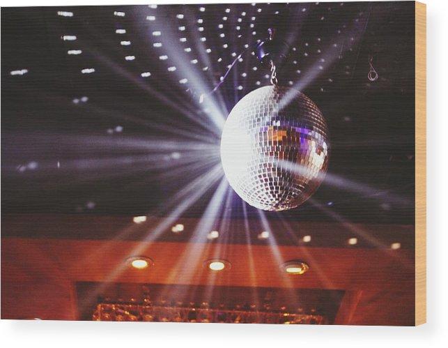 Hanging Wood Print featuring the photograph Disco Ball At Illuminated Nightclub by Shaun Wang / Eyeem