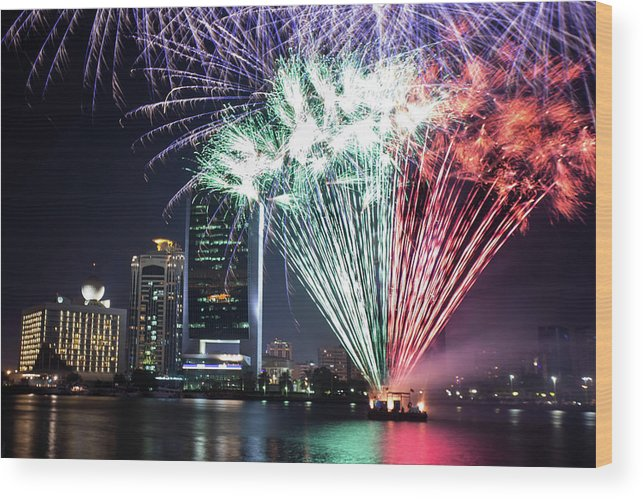 Firework Display Wood Print featuring the photograph Dubai Creek Fireworks by Shahin Olakara Photography