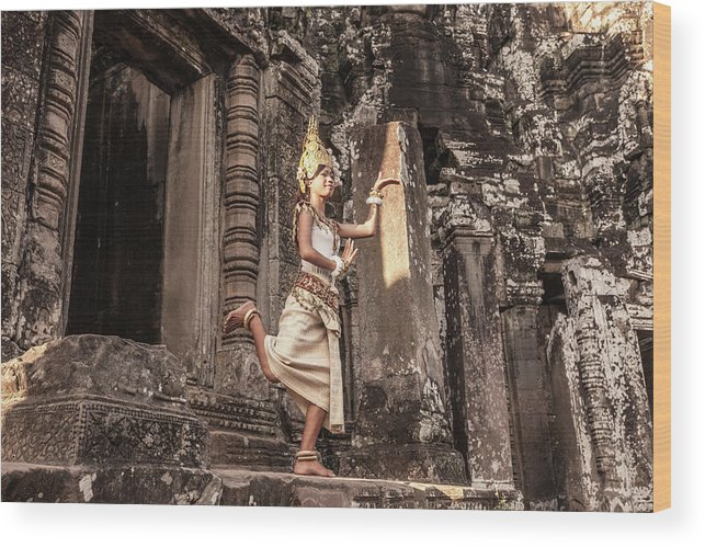 Hinduism Wood Print featuring the photograph Female Apsara Dancer, Standing On One by Cultura Exclusive/gary Latham