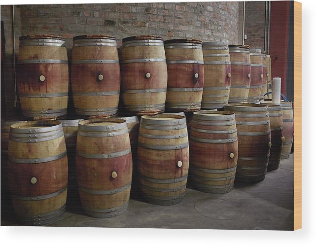 Stellenbosch Wood Print featuring the photograph French Wine Barrels Stacked At Winery by Klaus Vedfelt